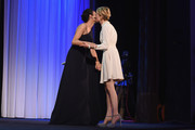Actress Alba Rohrwacher winner is greeted by festival hostess and actress Luisa Ranieri on stage after winning Best Actress award for Hungry Hearts on stage during the Closing Ceremony of the 71st Venice Film Festival on September 6, 2014 in Venice, Italy.