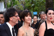"""(L-R) Official Jury president Joel Coen, jury members Sophie Marceau and Rossy de Palma attend the closing ceremony and Premiere of """"La Glace Et Le Ciel"""" (""""Ice And The Sky"""") during the 68th annual Cannes Film Festival on May 24, 2015 in Cannes, France."""