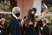 Kasia Smutniak and Domenico Procacci walk the red carpet ahead of closing ceremony at the 77th Venice Film Festival on September 12, 2020 in Venice, Italy.