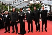 (FromL) Iranian actor Farid Sajjadihosseini, Iranian actor Babak Karimi, Iranian actress Taraneh Alidoosti, Iranian director Asghar Farhadi, Iranian actor Shahab Hosseini and French producer and distributor Alexandre Mallet-Guy pose as they arrive on May 22, 2016 for the closing ceremony of the 69th Cannes Film Festival in Cannes, southern France.  / AFP / ANNE-CHRISTINE POUJOULAT