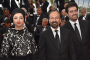 (FromL) Iranian actress Taraneh Alidoosti, Iranian director Asghar Farhadi and Iranian actor Shahab Hosseini pose as they arrive on May 22, 2016 for the closing ceremony of the 69th Cannes Film Festival in Cannes, southern France.  / AFP / LOIC VENANCE