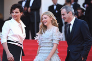 "(L-R) Actress Juliette Binoche, actress Chloe Grace Moretz and director Olivier Assayas attend the ""Clouds Of Sils Maria"" premiere during the 67th Annual Cannes Film Festival on May 23, 2014 in Cannes, France."