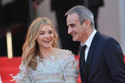 "(L-R) Chloe Grace Moretz and Olivier Assayas attend the ""Clouds Of Sils Maria"" premiere during the 67th Annual Cannes Film Festival on May 23, 2014 in Cannes, France."