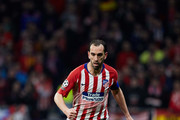 Diego Godin of Atletico de Madrid controls the ball during the UEFA Champions League Round of 16 First Leg match between Club Atletico de Madrid and Juventus at Estadio Wanda Metropolitano on February 20, 2019 in Madrid, Spain.