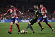 Cristiano Ronaldo (R) of Juventus competes for the ball with Diego Godin (L) of Atletico de Madrid during the UEFA Champions League Round of 16 First Leg match between Club Atletico de Madrid and Juventus at Estadio Wanda Metropolitano on February 20, 2019 in Madrid, Spain.
