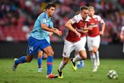 Rodri #14 of Atletico Madrid and Aaron Ramsey #8 of Arsenal compete for the ball during the International Champions Cup 2018 match between Club Atletico de Madrid and Arsenal at the National Stadium on July 26, 2018 in Singapore.