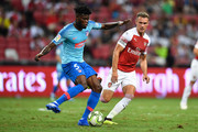 Thomas Partey #5 of Atletico Madrid and Aaron Ramsey #8 of Arsenal competes for the ball during the International Champions Cup 2018 match between Club Atletico de Madrid and Arsenal at the National Stadium on July 26, 2018 in Singapore.