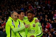 Neymar JR. (R) celebrates scoring their third goal with teammates Lionel Messi (2ndR) and  Andres Iniesta(L) during the Copa del Rey Round of 8 second leg match between Club Atletico de Madrid and FC Barcelona at Vicente Calderon Stadium on January 28, 2015 in Madrid, Spain.