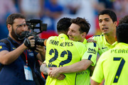 Daniel Alves and Lionel Messi of Barcelona embrace as they celebrate winning the title after the La Liga match between Club Atletico de Madrid and FC Barcelona at Vicente Calderon Stadium on May 17, 2015 in Madrid, Spain. Barcelona are champions after a 1-0 victory.