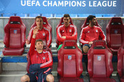 Thomas Mueller (front) sits on the bench with team mates Mario Goetze (L), Sven Ulreich (2R) and Serdar Tasci (4) prior to the UEFA Champions League semi final first leg match between Club Atletico de Madrid and FC Bayern Muenchen at Vincente Calderon on April 27, 2016 in Madrid, Spain.