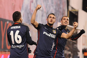 Antoine Greizmann of Club Atletico de Madrid celebrates with Koke and  Angel Correa  after scoring Atletico's 2nd goal during the La Liga match between Rayo Vallecano and Club Atletico de Madrid at Estadio de Vallecas on December 30, 2015 in Madrid, Spain.