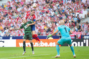 Diego Godin of Club Atletico de Madrid heads the ball while being challenged by Ruben Pena of SD Eibar during the La Liga match between  Club Atletico de Madrid and SD Eibar at Wanda Metropolitano on September 15, 2018 in Madrid, Spain.