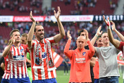 Diego Godin of Atletico Madrid applauds during a ceremony to mark his last home match for the club at the end of the La Liga match between  Club Atletico de Madrid and Sevilla FC at Wanda Metropolitano on May 12, 2019 in Madrid, Spain.