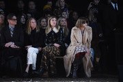 (L-R) Hamish Bowles, Tonne Goodman, Virginia Smith and Anna Wintour attends the Coach Fall 2018 Runway Show at Basketball City on February 13, 2018 in New York City.