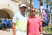 Former NBA player and head coach of Cal State Northridge Reggie Theus (L) attends the Coach Woodson Las Vegas Invitational Golf Tournament at Reflection Bay Golf Club on July 11, 2016 in Henderson, Nevada.
