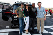 (L-R) Actors Sharlto Copley, Jessica Biel, Quinton 'Rampage' Jackson and Bradley Cooper pose at the start/finish line prior to the start of the NASCAR Sprint Cup Series Coca-Cola 600 at Charlotte Motor Speedway on May 30, 2010 in Concord, North Carolina.