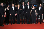 "Producer Tanya Seghatchian, actor Borys Szyc, actress Joanna Kulig,producer Ewa Puszczynska, actor Tomasz Kot and guest (R) attend the screening of ""Cold War (Zimna Wojna)"" during the 71st annual Cannes Film Festival at Palais des Festivals on May 10, 2018 in Cannes, France."