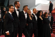 "Actor Tomasz Kot, director Pawel Pawlikowski, actress Joanna Kulig, actor Borys Szyc, producer Tanya Seghatchian, producer Ewa Puszczynska and guest (R) attend the screening of ""Cold War (Zimna Wojna)"" during the 71st annual Cannes Film Festival at Palais des Festivals on May 10, 2018 in Cannes, France."