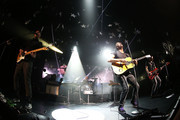 (L-R) Jonny Buckland, Will Champion, Chris Martin and Guy Berryman of Coldplay perform live for fans at Enmore Theatre on June 19, 2014 in Sydney, Australia.