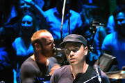 Will Champion and Jonny Buckland of Coldplay perform live on stage at the Royal Albert Hall on July 1, 2014 in London, England.