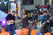 "(L-R) guitarist Jonny Buckland, singer Chris Martin, drummer Will Champion and bassist Guy Berryman of Coldplay perform on NBC's ""Today"" at Rockefeller Plaza on March 14, 2016 in New York City."
