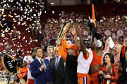 Head coach Dabo Swinney and Trayvon Mullen #1 of the Clemson Tigers celebrate their teams 44-16 win over the Alabama Crimson Tide with the trophy in the CFP National Championship presented by AT&T at Levi's Stadium on January 7, 2019 in Santa Clara, California.