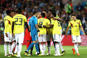 Colombia players protest to referee Mark Geiger after he awards England a penalty during the 2018 FIFA World Cup Russia Round of 16 match between Colombia and England at Spartak Stadium on July 3, 2018 in Moscow, Russia.