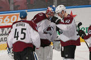 Goaltender Jonathan Bernier #45 and Gabriel Landeskog #92 congratulate goaltender Semyon Varlamov #1 of the Colorado Avalanche after the game against the Florida Panthers at the BB&T Center on December 9, 2017 in Sunrise, Florida. The Avalanche defeated the Panthers 7-3.