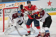 Carl Soderberg #34 of the Colorado Avalanche battles for position with Nick Bjugstad #27 of the Florida Panthers in front of goaltender Semyon Varlamov #1at the BB&T Center on December 9, 2017 in Sunrise, Florida. The Avalanche defeated the Panthers 7-3.