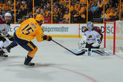 Craig Smith #15 of the Nashville Predators shoots wide of goalie Jonathan Bernier #45 of the Colorado Avalanche during the first period in Game One of the Western Conference First Round during the 2018 NHL Stanley Cup Playoffs at Bridgestone Arena on April 12, 2018 in Nashville, Tennessee.