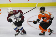 Gabriel Landeskog #92 of the Colorado Avalanche is held back by Claude Giroux #28 of the Philadelphia Flyers at the Wells Fargo Center on October 22, 2018 in Philadelphia, Pennsylvania.