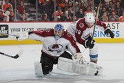 Ian Cole #28 of the Colorado Avalanche collides with Semyon Varlamov #1  during the second period against the Philadelphia Flyers at the Wells Fargo Center on October 22, 2018 in Philadelphia, Pennsylvania.
