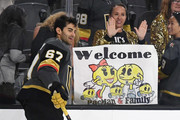 Max Pacioretty #67 of the Vegas Golden Knights skates past a fan holding up a sign welcoming him to the team during warmups before a preseason game against the Colorado Avalanche at T-Mobile Arena on September 24, 2018 in Las Vegas, Nevada. The Avalanche defeated the Golden Knights 5-3.