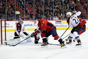 Goalie Semyon Varlamov #1 of the Colorado Avalanche blocks a shot by Alex Ovechkin #8 of the Washington Capitals in the second period at Capital One Arena on December 12, 2017 in Washington, DC.