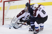 Semyon Varlamov #1 of the Colorado Avalanche keeps his eye on the puck as teammate Jan Hejda #8 puts pressure on Michael Frolik #67 of the Winnipeg Jets in first period action in an NHL game at the MTS Centre on February 8, 2015 in Winnipeg, Manitoba, Canada.