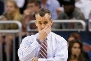 Head coach Billy Donovan of the Florida Gators looks on in the first half while taking on the Albany Great Danes during the second round of the 2014 NCAA Men's Basketball Tournament at Amway Center on March 20, 2014 in Orlando, Florida.