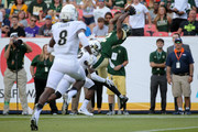 Rashard Higgins #82 of the Colorado State Rams makes a reception against John Walker #12 of the Colorado Buffaloes for a touchdown to take a 14-0 lead in the second quarter during the Rocky Mountain Showdown at Sports Authority Field at Mile High on September 19, 2015 in Denver, Colorado.