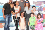 (L-R)  Daren Dukes, Daren O.C. Dukes, Shanola Hampton, Cai MyAnna Dukes, Steve Howey, Sarah Shahi, and Violet Moon Howey, William Wolf Howey, and Knox Blue Howey attend the Columbia Pictures and Sony Pictures Animation's world premiere of 'Hotel Transylvania 3: Summer Vacation' at Regency Village Theatre on June 30, 2018 in Westwood, California.