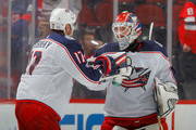 Sergei Bobrovsky #72 and Brandon Dubinsky #17 of the Columbus Blue Jackets celebrate after defeating the New Jersey Devils on February 20, 2018 at Prudential Center in Newark, New Jersey.