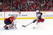 Cam Atkinson #13 of the Columbus Blue Jackets scores a goal on Philipp Grubauer #31 of the Washington Capitals in the first period during Game Two of the Eastern Conference First Round during the 2018 NHL Stanley Cup Playoffs at Capital One Arena on April 15, 2018 in Washington, DC.