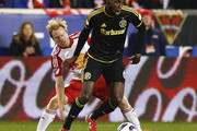 Tony Tchani #6 of Columbus Crew moves the ball from Dax McCarty #11 of New York Red Bulls during their match at Red Bull Arena on November 29, 2015 in Harrison, New Jersey.