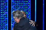 (L-R) Chris Redd hugs Alec Baldwin onstage during the Comedy Central Roast of Alec Baldwin at Saban Theatre on September 07, 2019 in Beverly Hills, California.