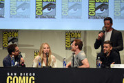 (L-R) Director Bryan Singer, actress Jennifer Lawrence, actor Michael Fassbender, actor Oscar Issac and (standing) actor Hugh Jackman speak onstage at the 20th Century FOX panel during Comic-Con International 2015 at the San Diego Convention Center on July 11, 2015 in San Diego, California.
