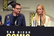 "Director Bryan Singer (L) and actress Jennifer Lawrence from ""X-Men: Apocalypse"" speak onstage at the 20th Century FOX panel during Comic-Con International 2015 at the San Diego Convention Center on July 11, 2015 in San Diego, California."