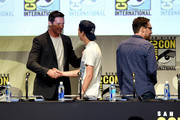 (L-R) Actor Hugh Jackman, actor Tye Sheridan and director Bryan Singer appear onstage at the 20th Century FOX panel during Comic-Con International 2015 at the San Diego Convention Center on July 11, 2015 in San Diego, California.