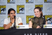 """Actosr Carlos Valdes (L) and Danielle Panabaker attend the """"Black Lightning"""" special video presentation and Q+A during Comic-Con International 2017 at San Diego Convention Center on July 22, 2017 in San Diego, California."""