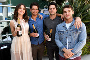 """(L-R) Actors Shelley Hennig, Tyler Posey, Dylan O'Brien, and Cody Christian from """"Teen Wolf"""" celebrate their final season backstage after their Hall H panel during Comic-Con International 2017 at San Diego Convention Center on July 20, 2017 in San Diego, California."""