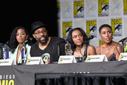 "(L-R) Nafessa Williams, Cress Williams, China Anne McClain, and Christine Adams speak onstage at the ""Black Lightning"" Special Video Presentation and Q&A during Comic-Con International 2018 at San Diego Convention Center on July 21, 2018 in San Diego, California."
