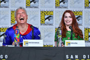 John Barrowman (L) and Felicia Day onstage at The Great Debate panel hosted by SYFY WIRE during Comic-Con International 2018 at San Diego Convention Center on July 19, 2018 in San Diego, California.
