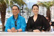 """Director Yimou Zhang  and actress Gong Li attend the """"Coming Home"""" photocall at the 67th Annual Cannes Film Festival on May 20, 2014 in Cannes, France."""